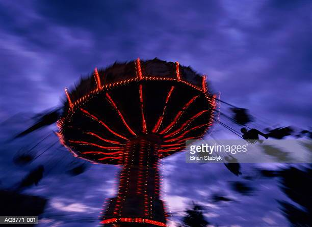 swing chair ride illuminated at night (blurred motion) - calgary stampede stock pictures, royalty-free photos & images
