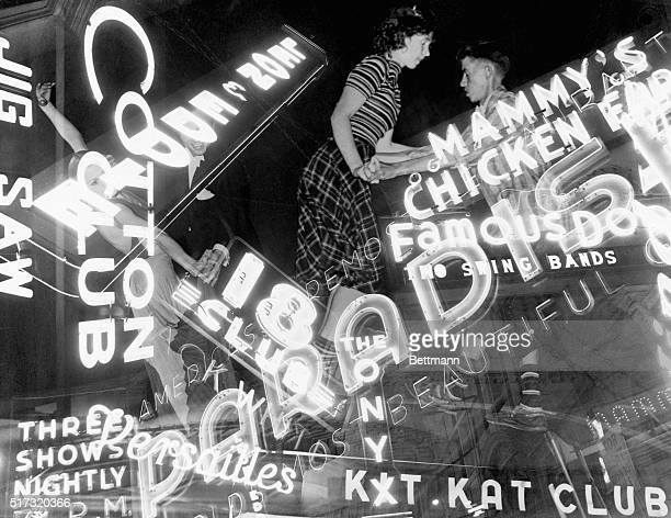 Swing dancers appear to soar amid the neon signs of New York City's popular clubs of the late 1930s.