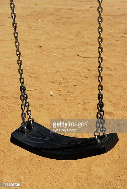 swing in children's playground - lyn holly coorg stock pictures, royalty-free photos & images