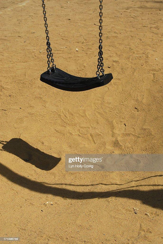 Swing in children's playground : Stock Photo