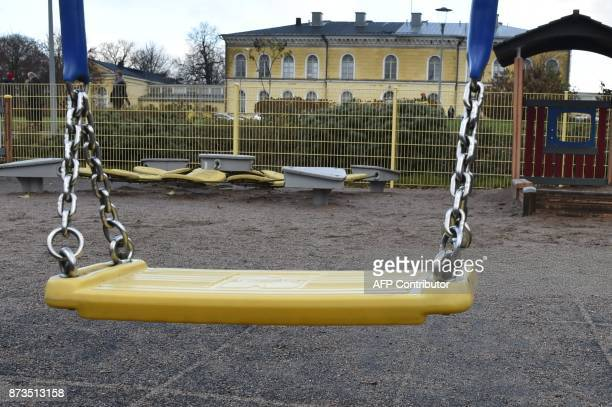 A swing is pictured at the childen's playground where a father stabbed his 3 yearold child in Lyseonpuisto Porvoo Finland on November 13 2017 Child...