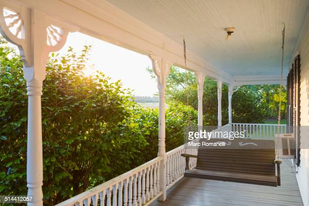 swing on porch of traditional house - southern usa stock pictures, royalty-free photos & images
