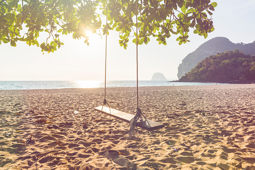 Swing on the beach at sunset - gettyimageskorea
