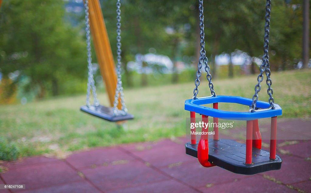 Swing on the playground. : Foto de stock