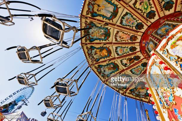 swing ride at the fair - agricultural fair stock pictures, royalty-free photos & images