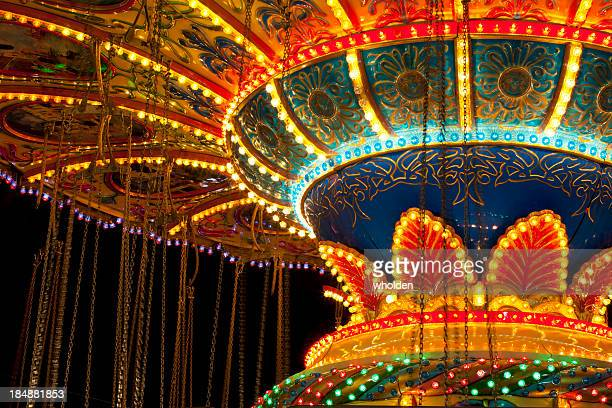 swing ride lights - midway stock photos and pictures