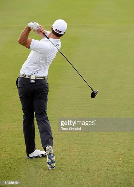 A swing sequence of Adam Scott of Australia in action during the proam event prior to the PGA Grand Slam of golf at Port Royal Golf Course on October...