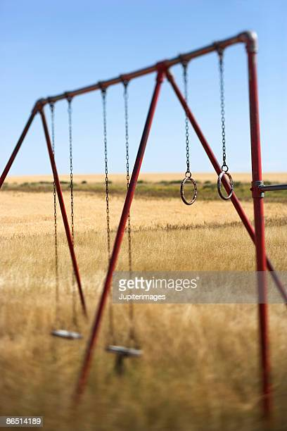 Swing set in rural field