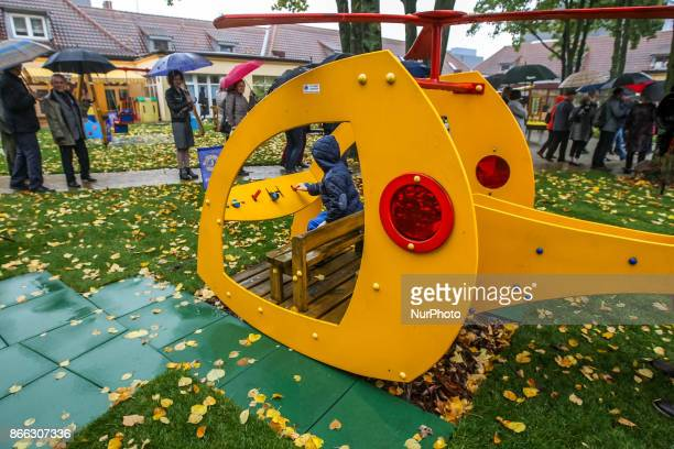 Swing slide cottage and other playground equipment in autumn scenery of ' Korczak Gardens ' is seen in Gdansk Poland on 21 October 2017 Lions Club...