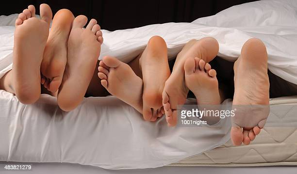 swingers - beautiful male feet stock photos and pictures