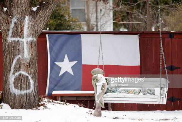 Swinging bench hangs from a tree after a snow storm on February 18, 2021 in Fort Worth, Texas. Winter storm Uri has brought historic cold weather and...