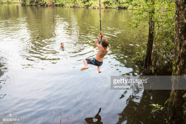 Swinging into the water with dad watching