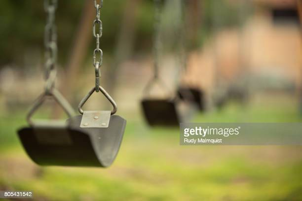 swinging - playground stock pictures, royalty-free photos & images