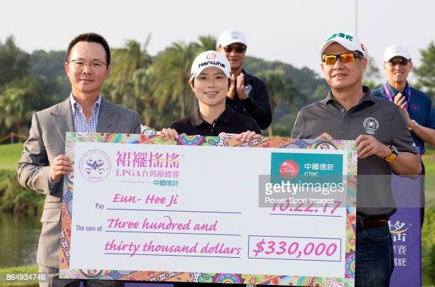 Swinging Skirts Golf Foundation Chairman Johnson Wang and CTBC ViceChairman Morris Li present the winners check to EunHee Ji of South Korea on the...