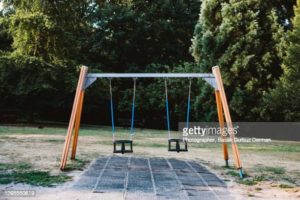 swings at children's playground - preschool stock pictures, royalty-free photos & images