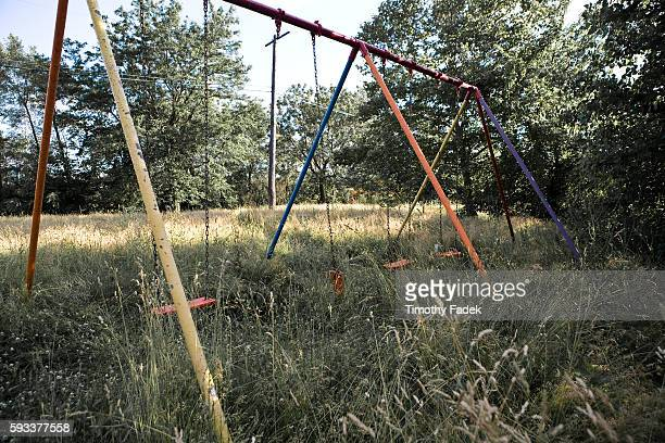 Swings in a playground overgrown with weeds The decadeslong decline of the US automobile industry is acutely reflected in the urban decay of Detroit...