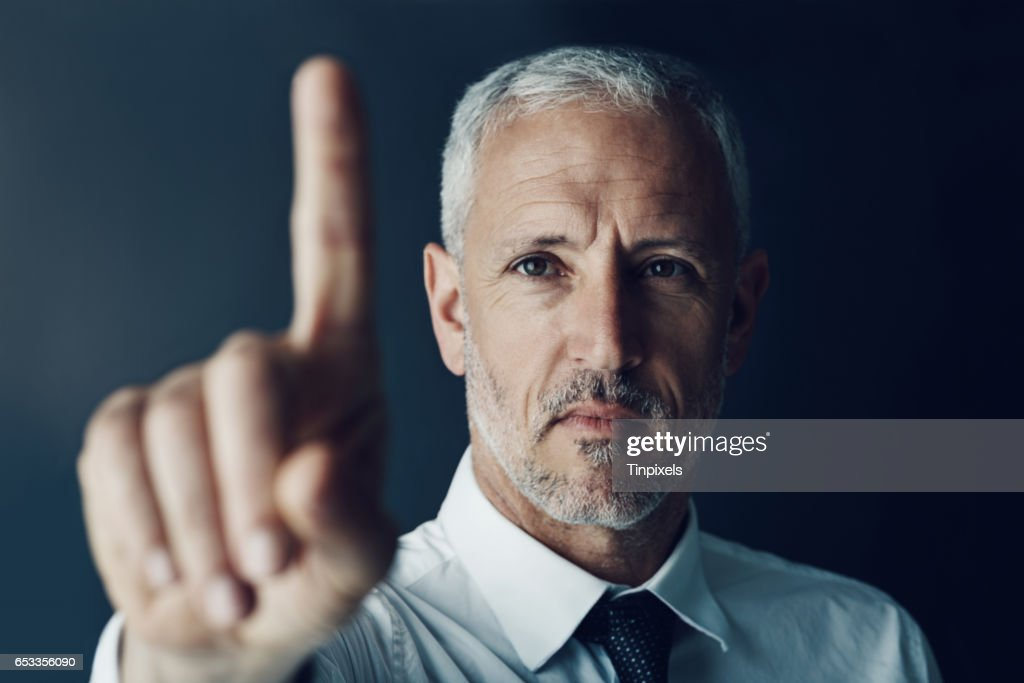 Swiping his way to success : Stock Photo