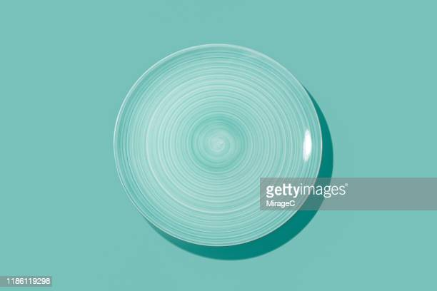 swirl brush pattern empty plate - plate stock pictures, royalty-free photos & images