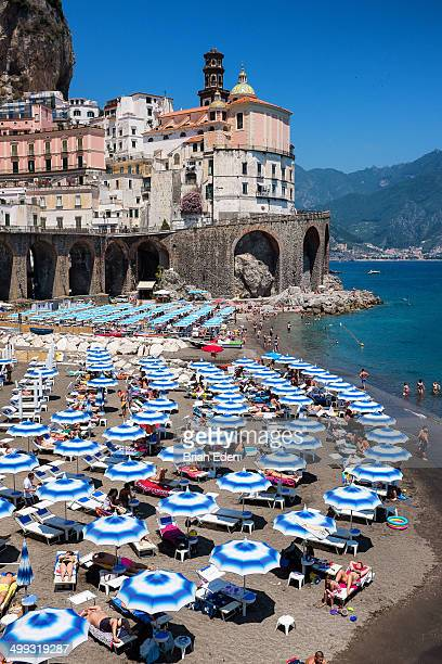 CONTENT] A swirl of blue umbrellas and sunbathers on a beach between Atrani and Amalfi Italy You can see the town of Amalfi at thew top of the cliff...