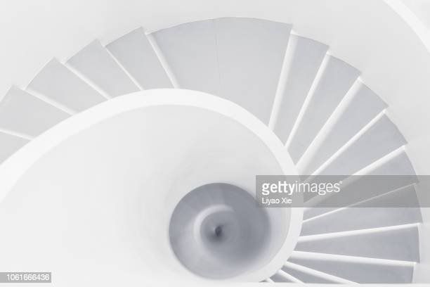swirl staris - staircase stock pictures, royalty-free photos & images