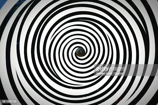 swirled pattern of black and white lines - illusion stock pictures, royalty-free photos & images