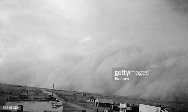 Swirling down upon this little town in Southeastern Colorado, a black and yellow blizzard of dust has brought the blight of death to livestock,...