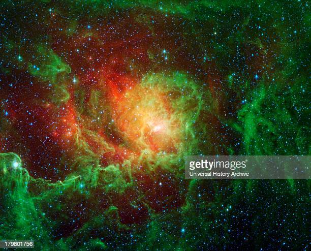 Swirling dust clouds and bright newborn stars dominate the view in this image of the Lagoon nebula from NASA's Spitzer Space Telescope. Also known as...
