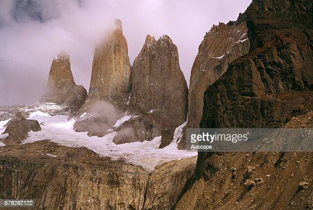 Swirling mist around Torres del Paine peaks Torre Central 2800 m Torre Sur d'Agostini on left 2850 m Torre Norte Monzino right 2600 m Torres del...