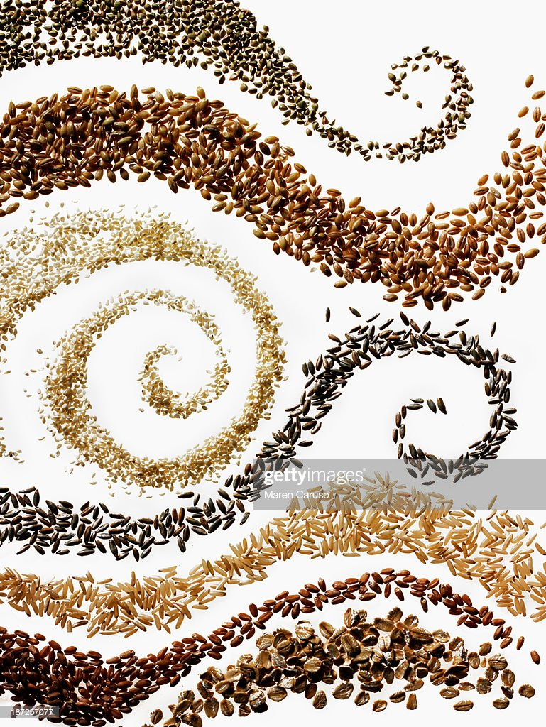 Swirls of Seven Grains on White Background : Stock Photo