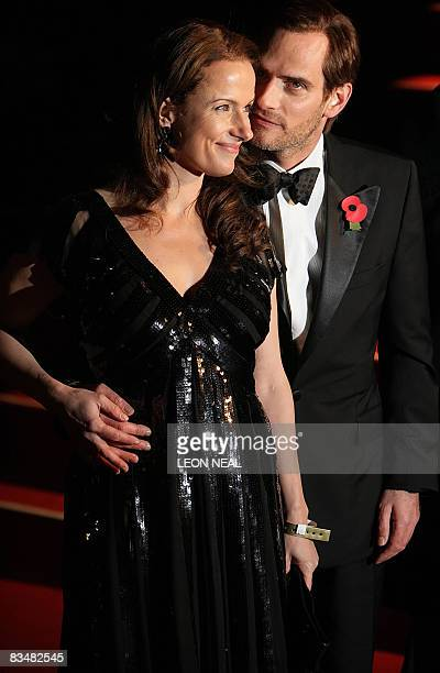 """Swiss actor Anatole Taubman and partner arrive for the world premiere of the new James Bond film """"Quantum of Solace"""" at the Odeon cinema in Leicester..."""