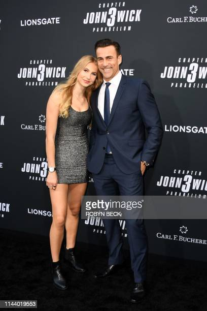 Swiss actor Daniel Bernhardt and daughter Bella arrive for the Los Angeles special screening of Lionsgate's John Wick Chapter 3 Parabellum at the TCL...