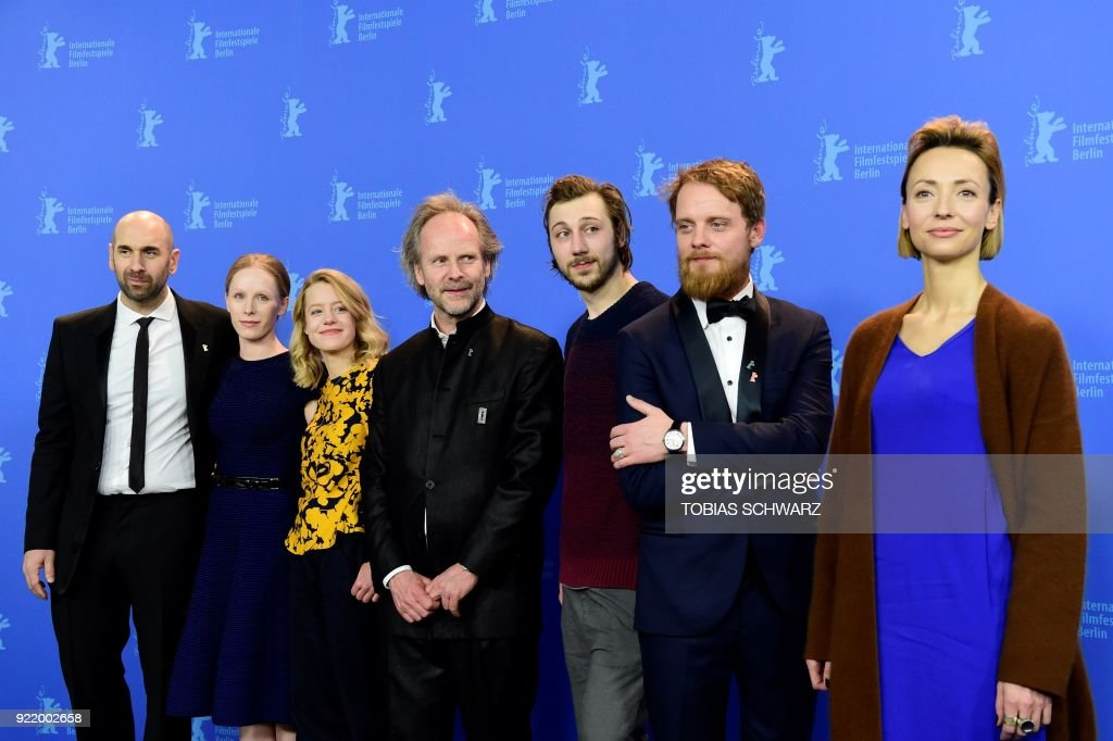 Swiss actor Urs Jucker, Austrian actress Susanne Wuest, German actress Julia Zange, German director Philip Groening, German actor Moritz Leu, German actor Stefan Konarske and Italian-Polish actress Karolina Porcari pose during the photo call for the film 'My Brother's Name is Robert and He is an Idiot' (Mein Bruder heisst Robert und ist ein idiot) presented in competition during the 68th edition of the Berlinale film festival in Berlin on February 21, 2018. / AFP PHOTO / Tobias SCHWARZ