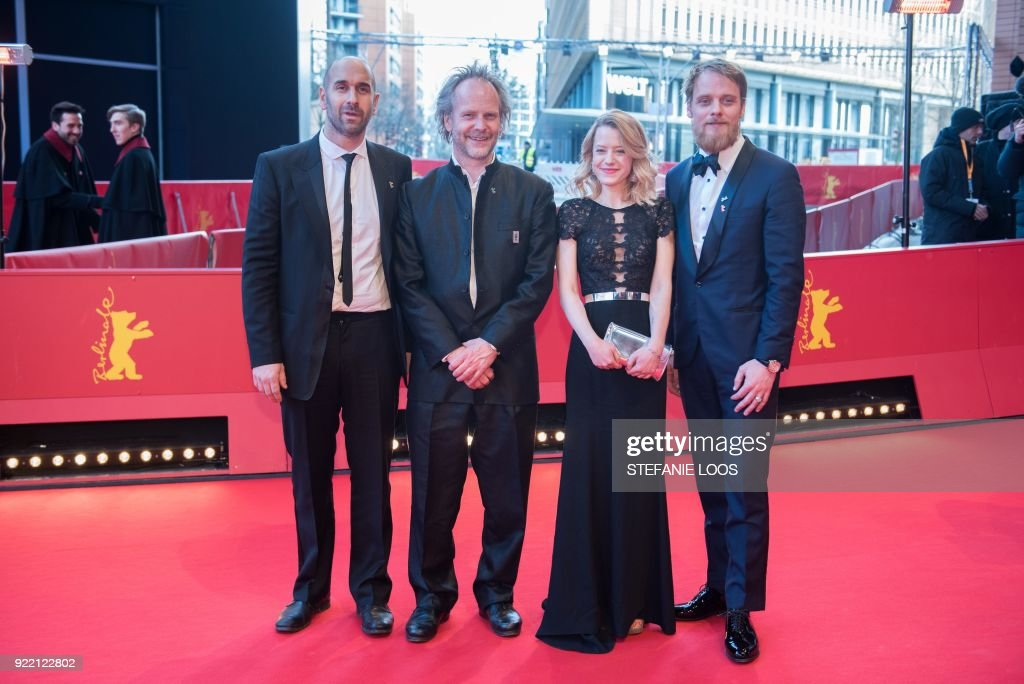 Swiss actor Urs Jucker, German director Philip Groening, German actress Julia Zange and German actor Stefan Konarske pose on the red carpet before the premiere of the film 'My Brother's Name is Robert and He is an Idiot' (Mein Bruder heisst Robert und ist ein idiot) presented in competition during the 68th edition of the Berlinale film festival in Berlin on February 21, 2018. / AFP PHOTO / Stefanie Loos