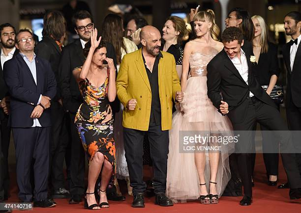 Swiss actress Aomi Muyock Argentinean director Gaspar Noe Danish actress Klara Kristin and US actor Karl Glusman dance as they arrive for the...