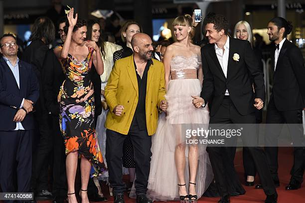 Swiss actress Aomi Muyock Argentinian director Gaspar Noe Danish actress Klara Kristin and US actor Karl Glusman dance as they arrive for the...