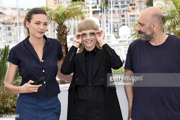 Swiss actress Aomi Muyock Danish actress Klara Kristin and Argentinian director Gaspar Noe pose during a photocall for the film Love at the 68th...