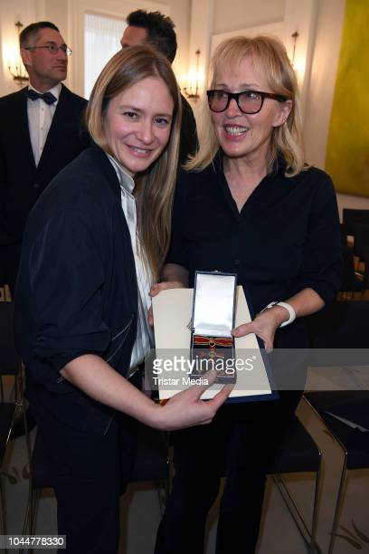 Swiss actress Julia Jentsch snd german singer Annette Humpe during the awarding with the Order of Merit of the Federal Republic of Germany on the...