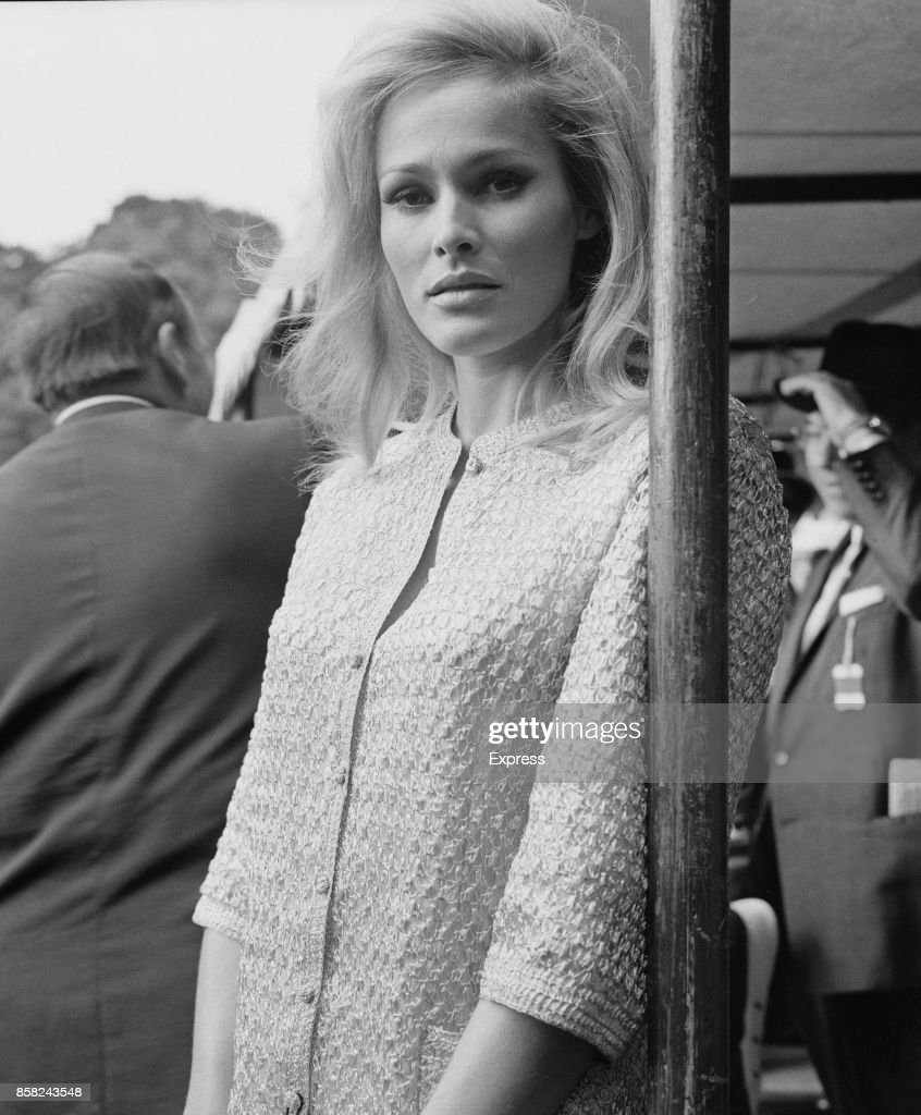 Swiss actress Ursula Andress attends a race meeting to raise money for charity at Sandown Park Racecourse, Escher, Surrey, UK, 31st August 1964.