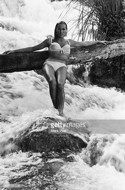Swiss actress Ursula Andress poses in a rushing stream during the filming of the James Bond movie Dr No in Jamaica