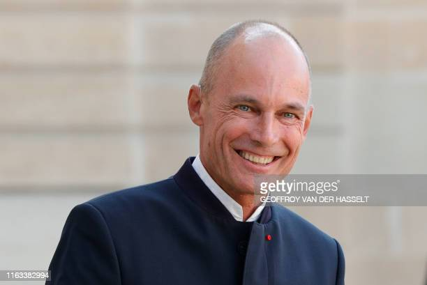 Swiss aeronaut and chair of the Solar Impulse foundation Bertrand Piccard speaks at the Elysee presidential palace in Paris on August 23 after taking...