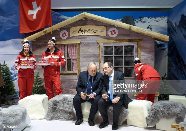 Swiss Agriculture Minister Johann SchneiderAmmann talks with the German German Agriculture Minister Christian Schmidt at the Swiss booth on the...