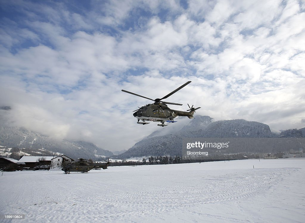 A Swiss Air Force helicopter takes off from a snow-covered field in Thusis, Switzerland, on Tuesday, Jan. 22, 2013. As policy makers and executives debate the latest remedies to draw a line under Europe's worst crisis since World War II, Swiss officers are now using the World Economic Forum as a testing ground for plans to turn the entire country into a fortress. Photographer: Simon Dawson/Bloomberg via Getty Images