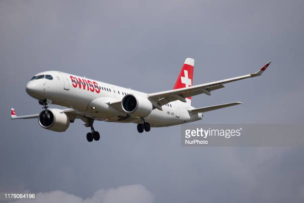 Swiss Airbus A220-300 aircraft with registration HB-JCD as seen on final approach landing at London Heathrow International Airport LHR EGLL in...