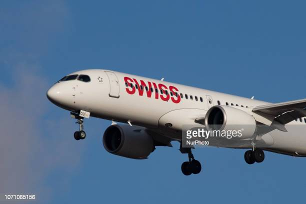 Swiss Airbus A220-300 aircraft with registration HB-JCQ landing at London Heathrow Airport in England, UK in the blue sky. The Airbus A220 is a new...