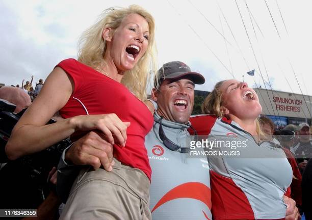Swiss Alinghi skipper Russell Coutts celebrates with Alinghi syndicate head Ernesto Bertarelli's wife Kirsty and Bertarelli's sister Dona after their...