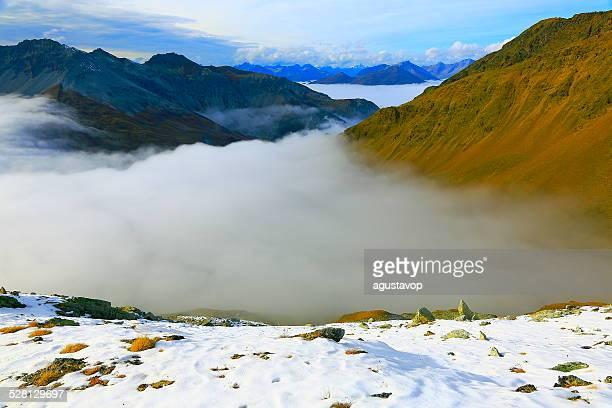 Swiss alpine landscape above clouds, Stilfser Joch - Stelvio pass