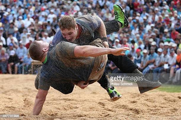 Swiss Alpine wrestler Joel Wicki fights on top with Marcel Kuster during the Alpine Wrestling Festival BruenigSchwinget at the top of the Bruenig...