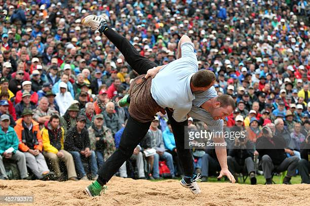 Swiss Alpine wrestler Matthias Sempach fights with Adrian Laimbacher during the Alpine Wrestling Festival BruenigSchwinget at the top of the Bruenig...