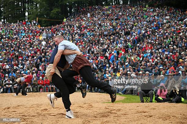 Swiss Alpine wrestler Matthias Siegenthaler fights with Andreas Ulrich during the Alpine Wrestling Festival BruenigSchwinget at the top of the...