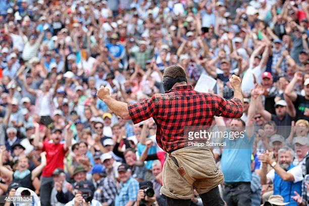 Swiss Alpine wrestler Melk Britschgi jubilates after winning a fight during the Alpine Wrestling Festival BruenigSchwinget at the top of the Bruenig...